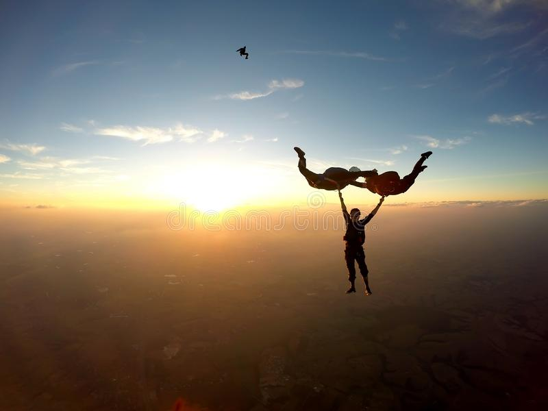 Skydivers having fun at the sunset stock photography
