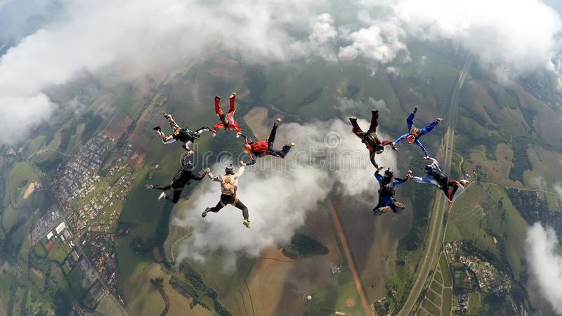 Skydivers making two circles royalty free stock photography