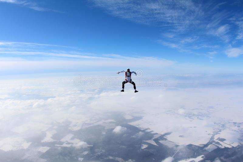 skydiving 跳伞运动员在云彩上坐 库存图片