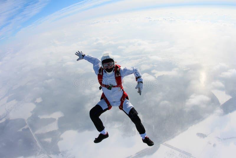 skydiving 跳伞运动员在云彩上坐 免版税库存图片