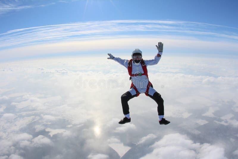 skydiving 跳伞运动员在云彩上坐 免版税库存照片