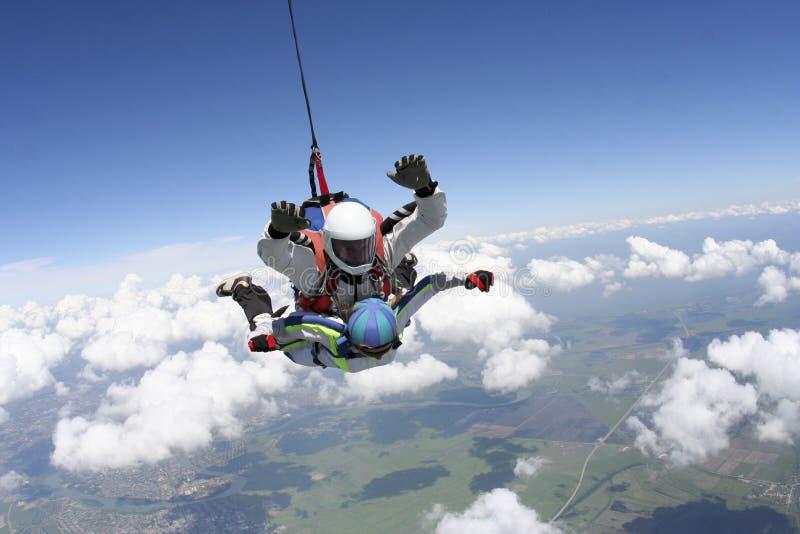 Skydiving foto. Tandemcykel. royaltyfria foton