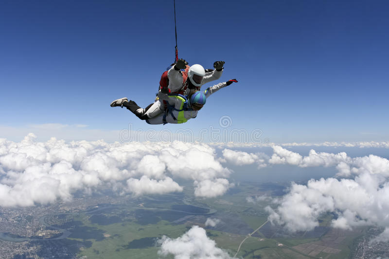 Skydiving foto. Tandemcykel. royaltyfri fotografi