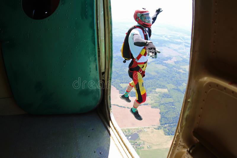 Skydiving. The moment of exit. stock image
