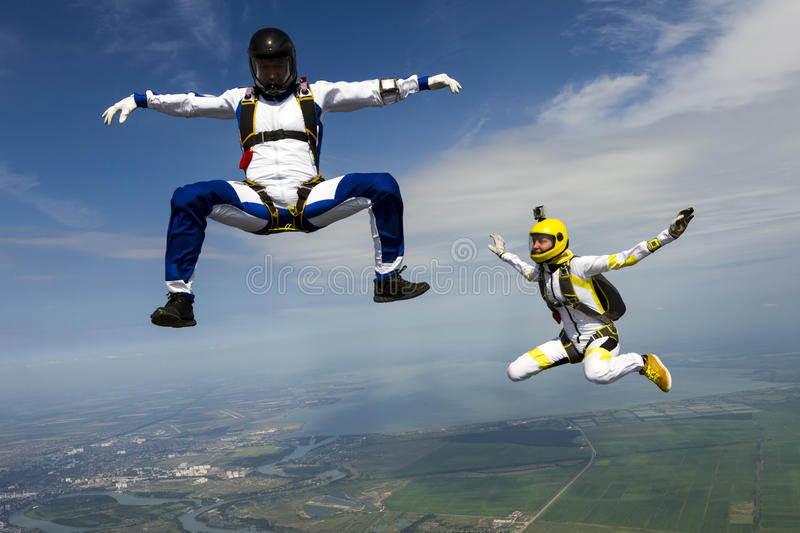 Skydiving photo. Girl and guy skydivers in freefall stock photo