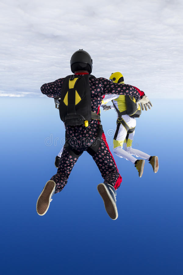 Skydiving photo. A girl and a guy skydivers perform pieces in free fall royalty free stock photos