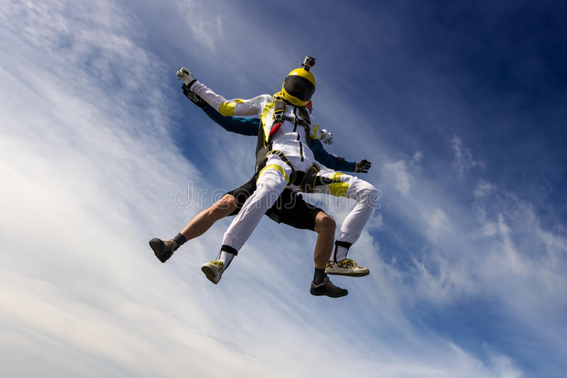 Skydiving photo. A girl and a guy skydivers perform pieces in free fall stock photography