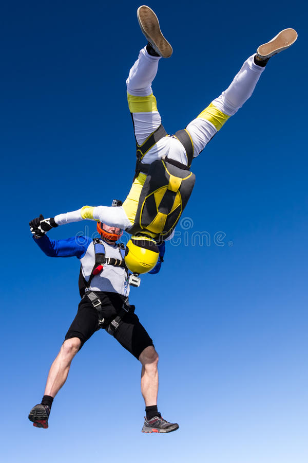 Skydiving photo. A girl and a guy skydivers perform pieces in free fall stock photos