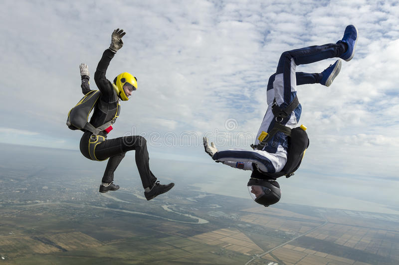 Skydiving photo. A girl and a guy skydivers perform pieces in free fall royalty free stock photography