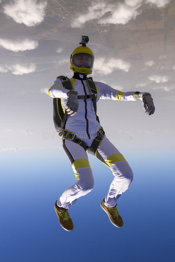 Skydiving photo. The girl parachutist in free style stock photos