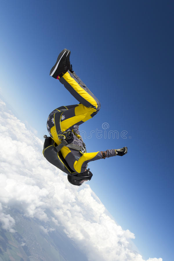 Skydiving photo. A girl performs in a free fall free style stock photos