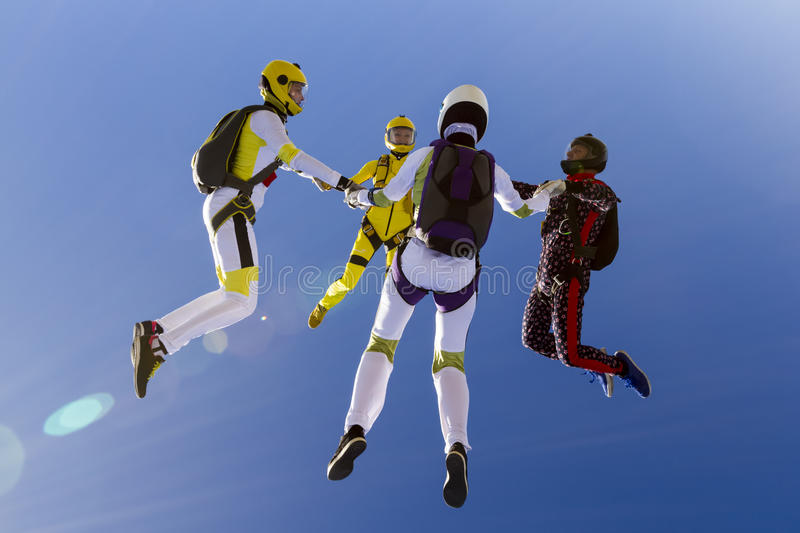 Skydiving photo. Group collects figure skydivers in freefall royalty free stock images