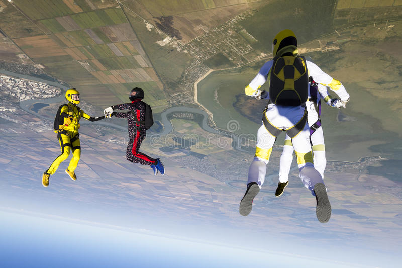 Skydiving photo. Group collects figure skydivers in freefall vector illustration