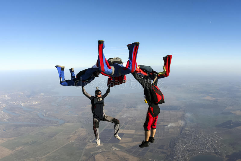 Skydiving photo. Group of skydivers in freefall royalty free stock photo