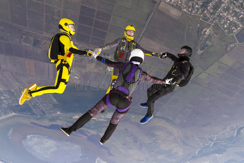 Skydiving photo. Group of skydivers in freefall stock photos