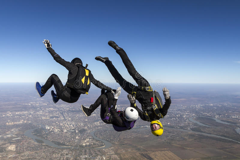 Skydiving photo. Group of skydivers in freefall stock images