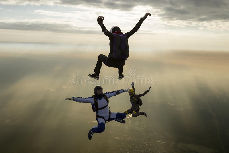 Skydiving photo. Group of skydivers in freefall stock photography