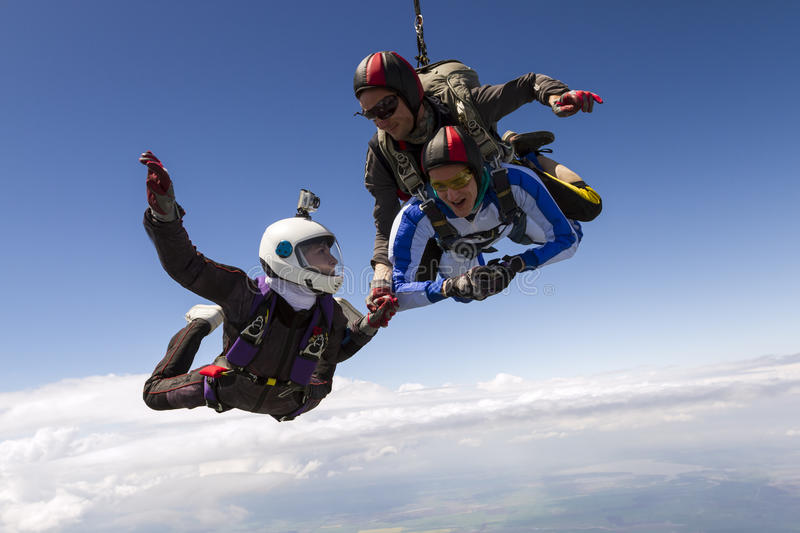 Skydiving photo. Parachutist student in tandem with an instructor stock photos
