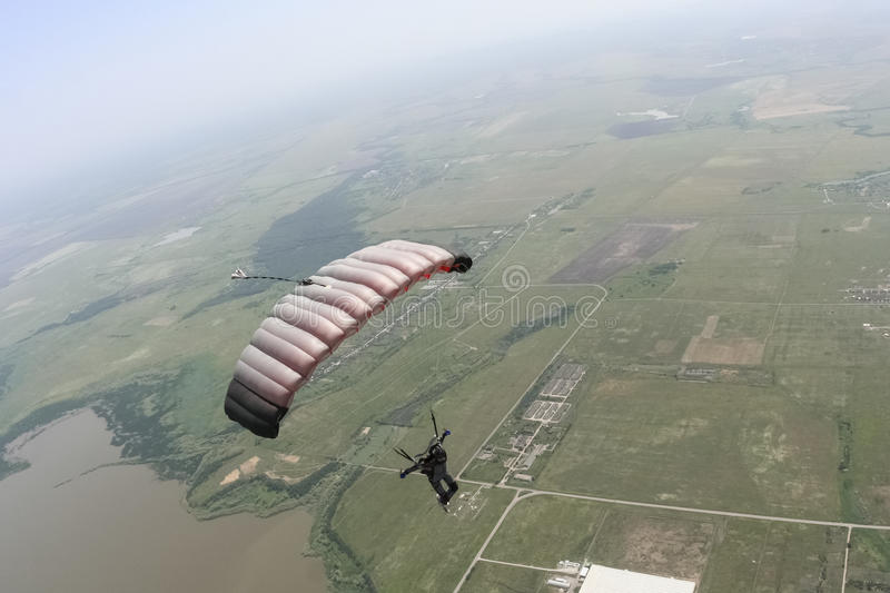 Skydiving photo. Piloting the parachute in the clouds royalty free stock photo
