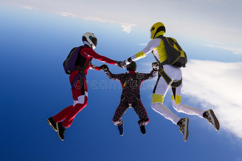 Skydiving photo. Sports parachutist build a figure in free fall royalty free stock photos