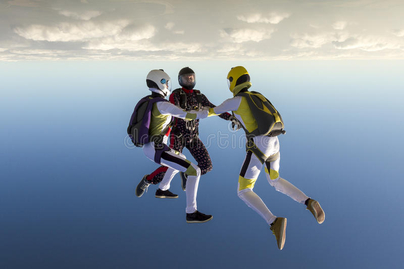 Skydiving photo. Sports parachutist build a figure in free fall royalty free stock images