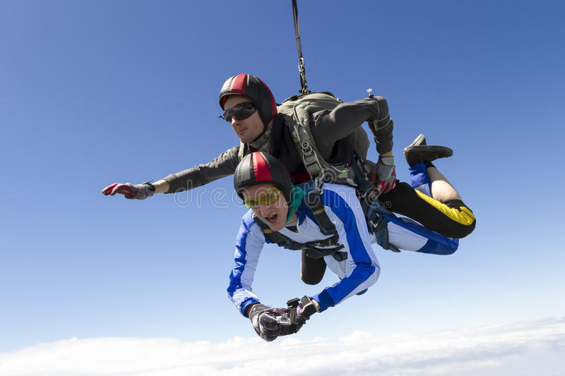 Skydiving photo. Tandem jump. The instructor and the student in freefall royalty free stock photography