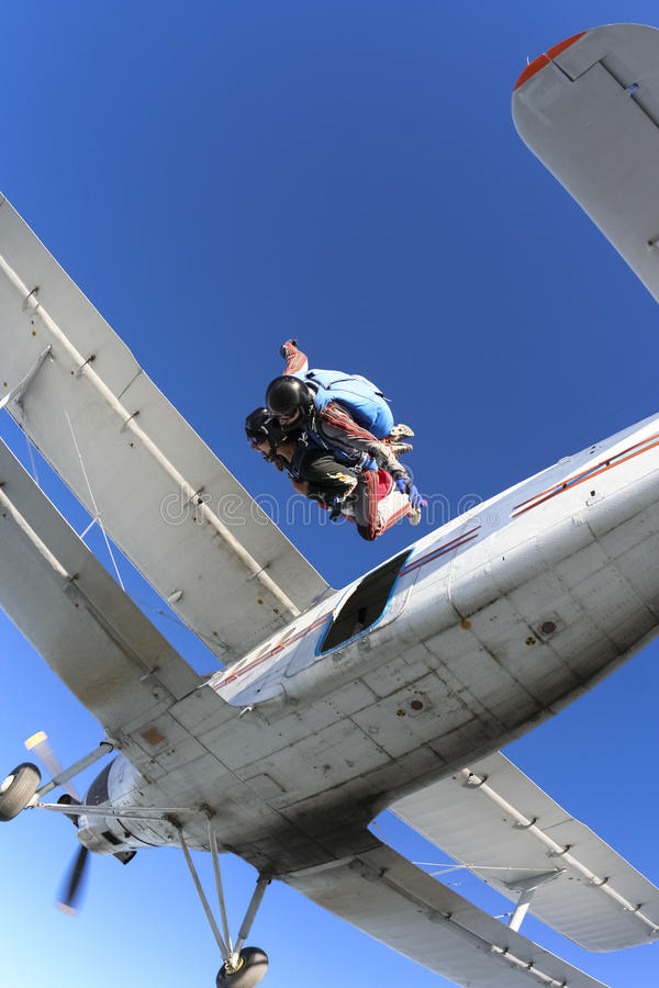 Skydiving photo. Tandem. Tandem jump. Jump out of a plane and fly back stock photos