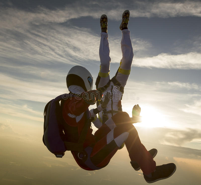 Skydiving photo. Two girls in free fall royalty free stock images