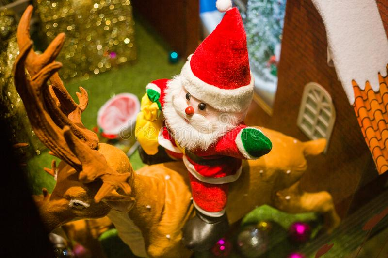 Ride a deer Santa Claus toys in the window royalty free stock images