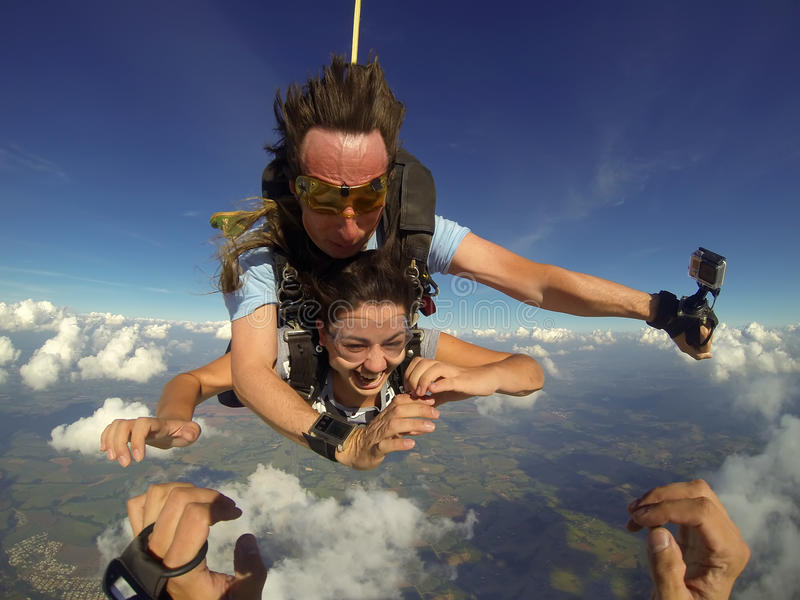 Skydiving tandem couple pov stock photo