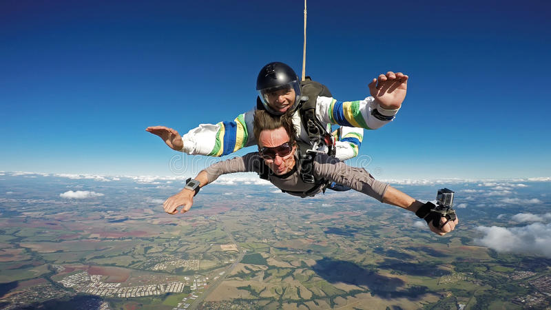 Skydiving tandem friends open arms stock photos