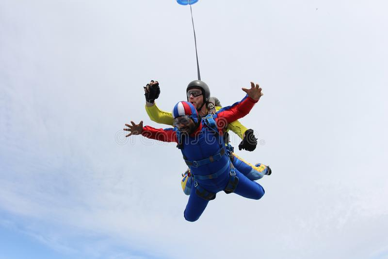 Skydiving. Tandem jump. Instructor and indian passenger. royalty free stock image