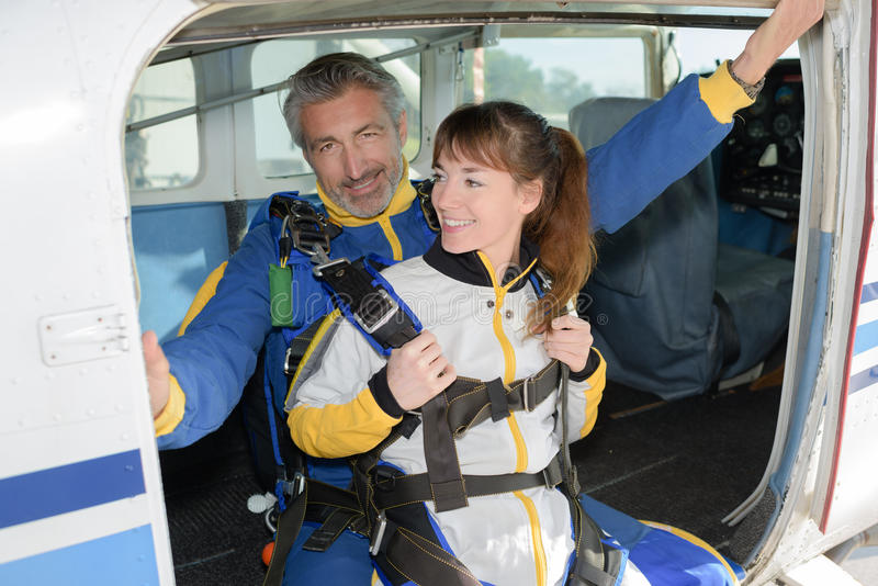 Skydiving tandem jumping from plane royalty free stock photo