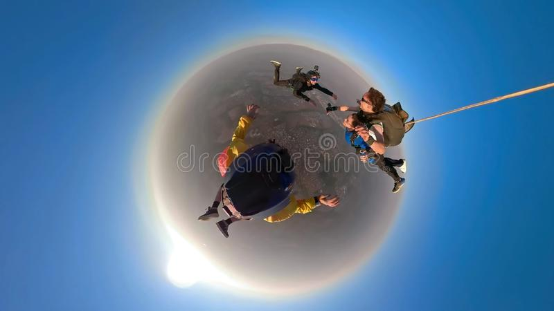 Skydiving tandem small planet royalty free stock photo