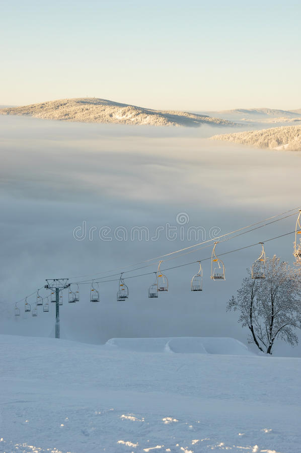 Chair lift in skying resort royalty free stock photo