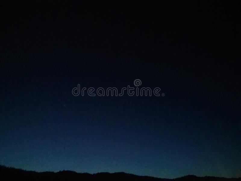 Skylight mountains royalty free stock photography