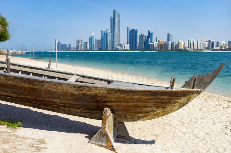 The skyline of abu dhabi with a boat in front stock images