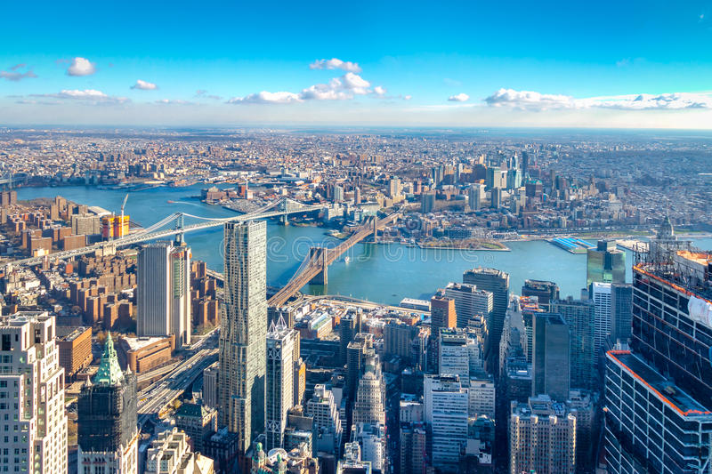 Skyline aerial view of Manhattan with skyscrapers, East River, Brooklyn Bridge and Manhattan Bridge - New York, USA. Skyline aerial view of Manhattan with royalty free stock photography