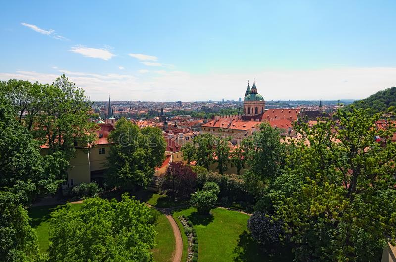 Skyline aerial view of old town Prague, ancient buildings and red tile roofs against blue sky. Selective focus with wide angle lens. Spring sunny day. Prague stock image