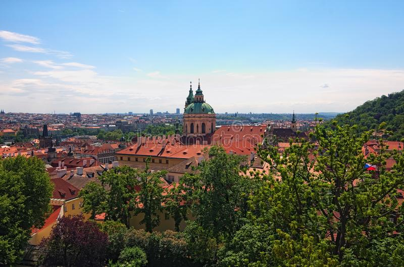 Skyline aerial view of old town Prague, ancient buildings and red tile roofs against blue sky. Spring sunny day. Prague. Czech Republic royalty free stock photography
