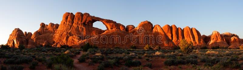 Skyline Arch at Sunset - stitched panrama stock photo