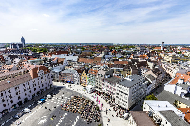 Skyline of Augsburg with famous old town hall. AUGSBURG, GERMANY - APR 29, 2015: skyline of Augsburg with famous old town hall and half timbered houses royalty free stock photography