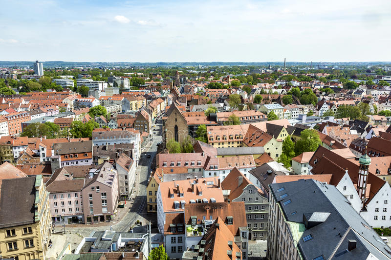 Skyline of Augsburg with famous old town hall. AUGSBURG, GERMANY - APR 29, 2015: skyline of Augsburg with famous old town hall and half timbered houses royalty free stock photos