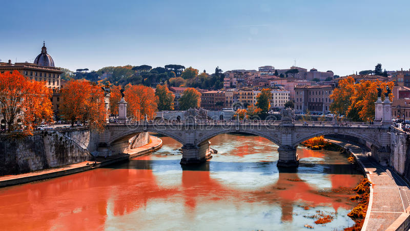 Skyline with bridge Ponte Vittorio Emanuele II and classic architecture in Rome, Vatican City scenery over Tiber river. Autumn vi stock photos