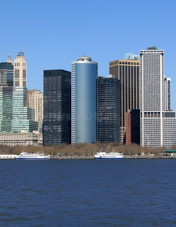 Skyline of buildings in New York against blue sky.