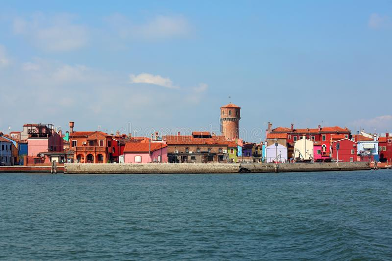 Skyline of Burano Island in Italy and the old aqueduct tower royalty free stock images