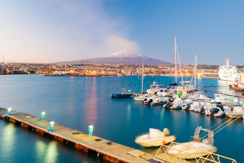 Skyline of Catania with snowy volcano Etna in background stock images