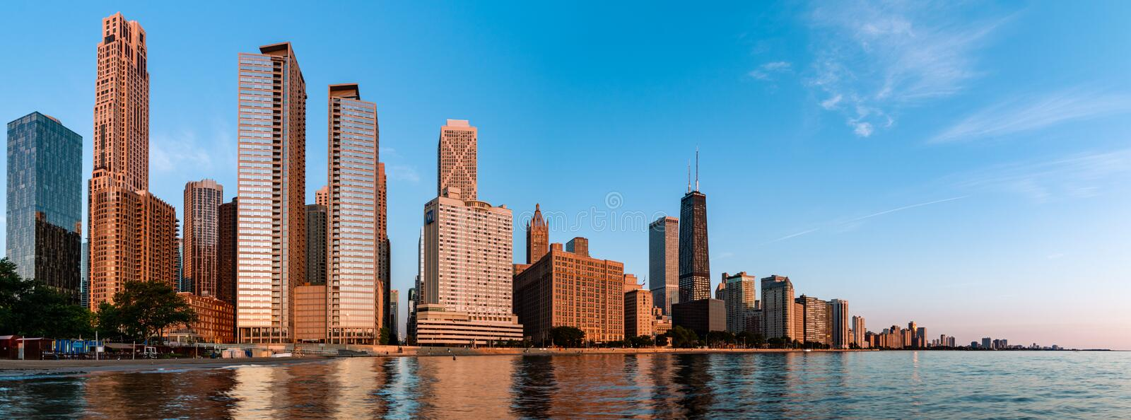 Skyline of Chicago during sunrise. The skyline from Chicago seen from Lake Michigan during sunrise. The rising sun gives a nice warm glow to the buildings royalty free stock photo