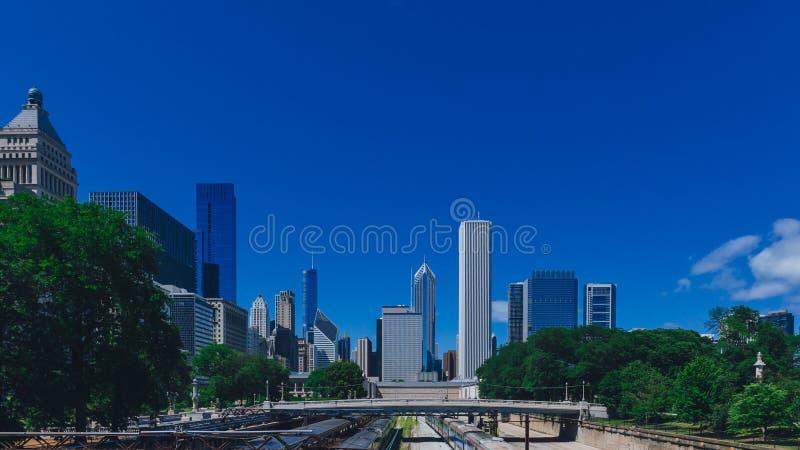 Skyline of Chicago, USA with bridge over train tracks stock image