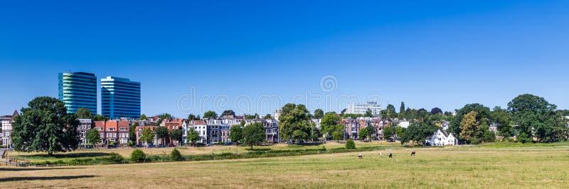 Skyline city Arnhem in the Netherlands. Skyline of city Arnhem, Netherlands, with Park Sonsbeek in the foreground stock image